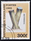 REPUBLIC OF TOGO - CIRCA 1999: A stamp printed in Togo shows Tourmaline circa 1999