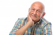 pic of retirement age  - Portrait of a happy senior man smiling isolated on white - JPG