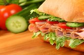 stock photo of tomato sandwich  - Fresh ham sandwich on wooden board  - JPG