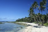 stock photo of surigao  - white sand beach ringed by palm trees cloud nine surf break siargao island in the philippines - JPG