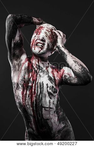 Concept of pain, a man with blood on his wounds and skin