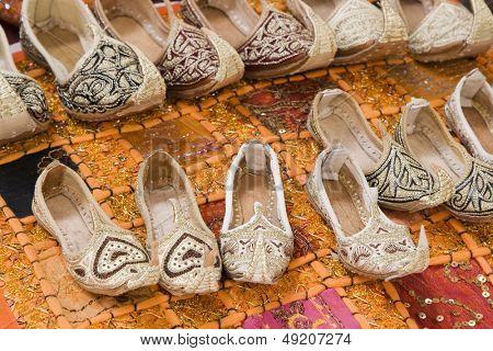 Dubai UAE Genie style sandals are for sale in the Bur Dubai souq in women\x90s and children\x90s sizes.
