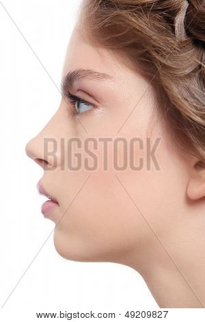 Profile portrait of young beautiful woman with clear make-up, over white background