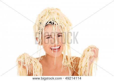 Young beautiful woman with spaghetti noodles on her hairs