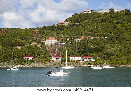 Expensive villas and boats at St  Jean Bay at St. Barts, French West Indies