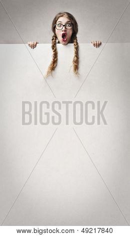 amazed girl with long braids