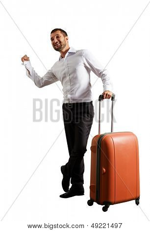 smiley young businessman hitch hiking over white background