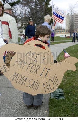 Young Boy Holds Tea Pot Cutout Sign.