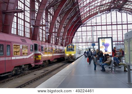 ANTWERP, BELGIUM - JUNE 23: Commuter train arrives to the Central station of Antwerp, Belgium on June 23, 2013. Since 2007, 3 more levels for high-speed trains opened under the usual station