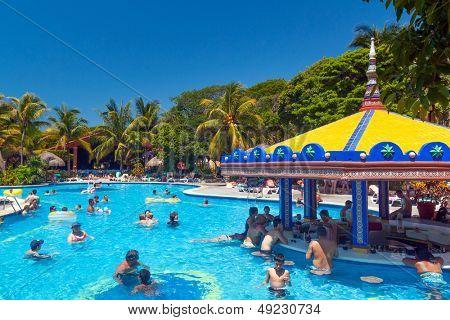 PLAYA DEL CARMEN, MEXICO - JULY 20: Scenery of luxury swimming pool at RIU Yucatan Hotel  in Playa del Carmen on July 20, 2011. RIU Hotels & Resorts has more than 100 hotels in 19 countries.