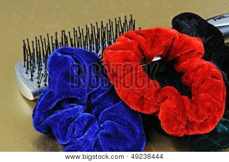 Hairbrush with velvet hair ties.