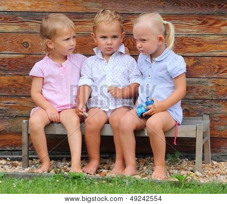 Funny siblings on a rural bench.
