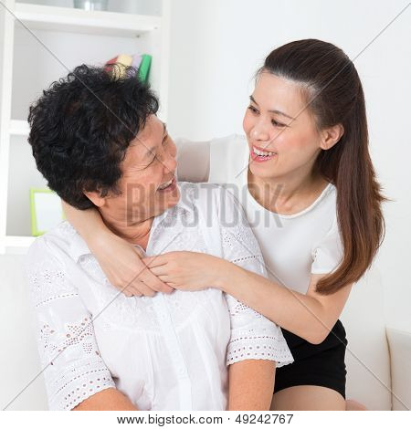 Senior woman and daughter. Happy Asian family senior mother and adult offspring having fun time at home.