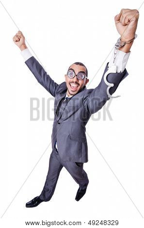 Funny businessman with handcuffs on white