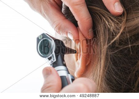 Examining Ear With Otoscope