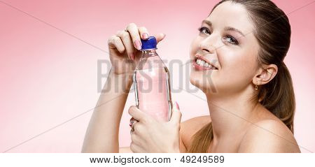 Young beautiful girl with bottle of water