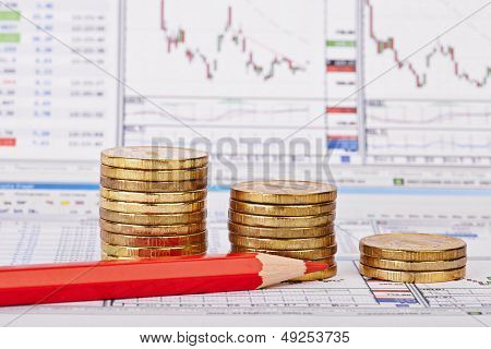 Downtrend Coins Stacks, Red Pencil, Financial Chart As Background, Red Pencil. Selective Focus