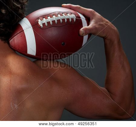 American Football Player holding a Ball