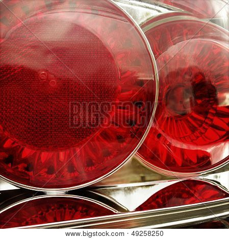Closeup of red tail lights on car