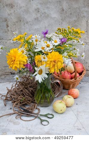Bouquet Of Yellow Flowers And Chamomiles And Apples Still Life