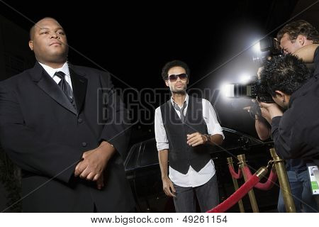 Male celebrity being photographed at media event