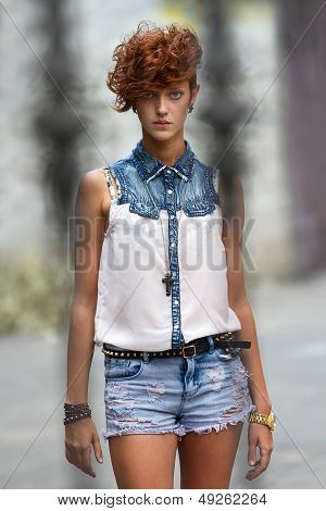 Hipster Girl In Leather Accessories With Spikes