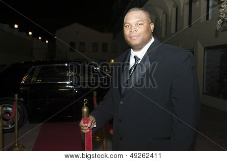 Portrait of a confident African American bouncer outside venue