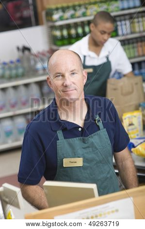 Portrait of a supermarket employee and checkout assistant