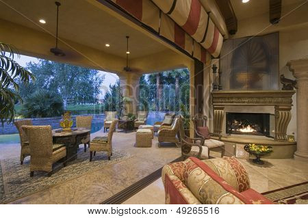 Open plan sitting room by lit fire with view of porch