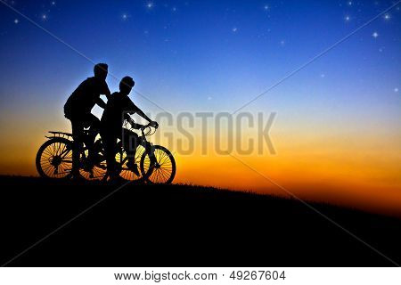 Cyclists At Sunset.