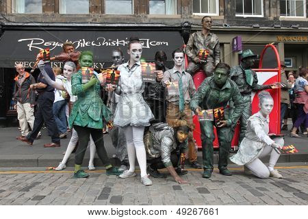 EDINBURGH- AUGUST 10: Members of Babolin Theatre publicize their show Sentinels during Edinburgh Fringe Festival on August 10, 2013 in Edinburgh, Scotland
