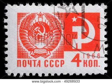 """USSR - CIRCA 1966: A stamp printed in USSR from the """"Society and Technology"""" issue shows the Coat of Arms and communism emblem, circa 1966."""