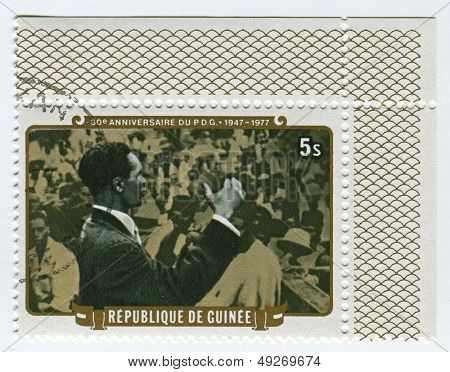 GUINEA - CIRCA 1977: A stamp printed in Guinea shows image of the Democratic Party of Guinea-African Democratic Rally is a political party in Guinea, circa 1977.