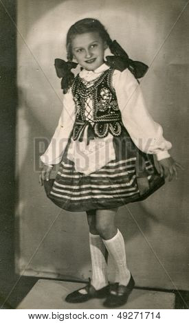 LODZ, POLAND, CIRCA FIFTIES - vintage photo of little girl in folk costume, Lodz, Poland, circa fifties