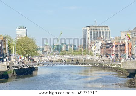DUBLIN, IRELAND - JUNE 7: Millenium Bridge and Ha'penny Bridge, River Liffey Dublin, Ireland on June 7, 2013