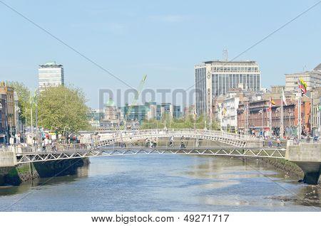 DUBLIN, IRELAND - JUNE 7: Millenium Bridge and Ha'penny Bridge, River Liffey Dublin, Ireland on June 7, 2013