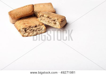 A few dog treats on a white surface