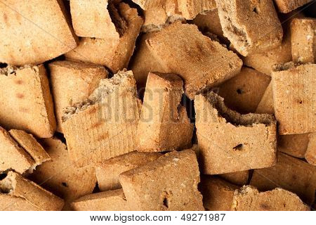 Background of broken dog treats