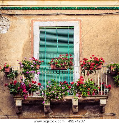 Beautiful Vintage Balcony With Colorful Flowers And Door