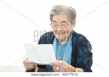 Old lady reading letter
