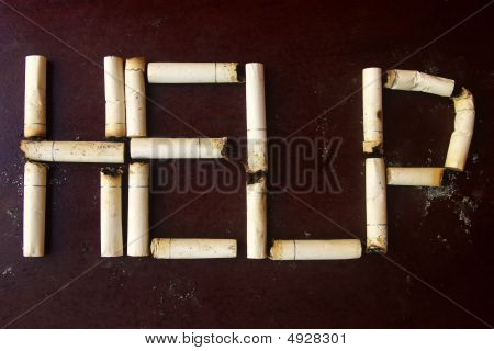 Cigarette Stubs Form The Word Help