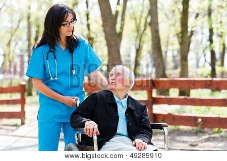 Senior Patient Talking With Kind Nurse