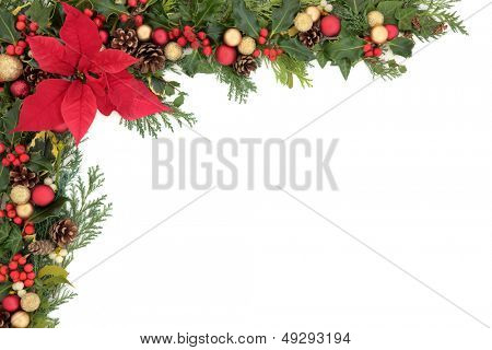 Christmas and winter floral border with poinsettia flower, decorations, natural holly, mistletoe and ivy,  over white background.