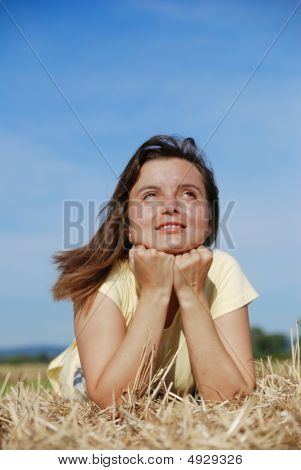 Young Woman Lying In Hay
