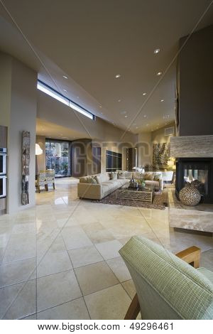 Spacious house with tiled floor and living room in background