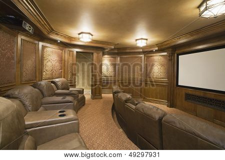 View of an entertainment room with leather seats and lit lights