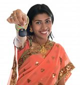 foto of sari  - Attractive traditional Indian woman in sari holding her first own car key isolated on white background - JPG