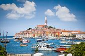 stock photo of marina  - Panoramic view on old town Rovinj from harbor - JPG