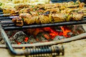 foto of kababs  - beef kababs on the grill closeup at camping site - JPG