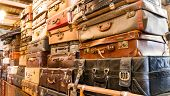 picture of carry-on luggage  - Pile of old vintage bag suitcases in shop - JPG